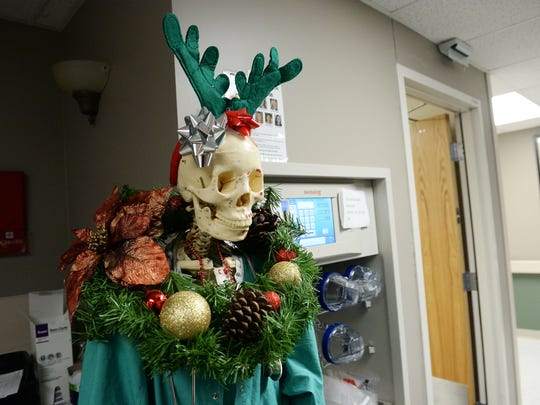 A festive skeleton is part of the holiday decor on the neuro unit at Poudre Valley Hospital on Wednesday, December 21, 2016.