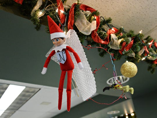 An Elf on the Shelf is part of the holiday decor on