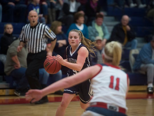 Dallastown's Grace Coyne moves the ball up the court