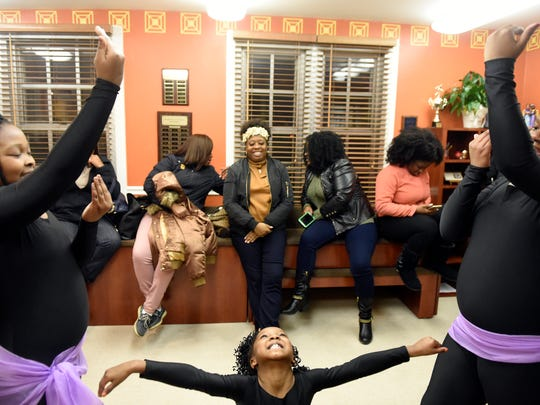 Members of Tri-State Glitter get ready to perform during the Annual community Kwanzaa Celebration at the Evansville African American Museum Tuesday.