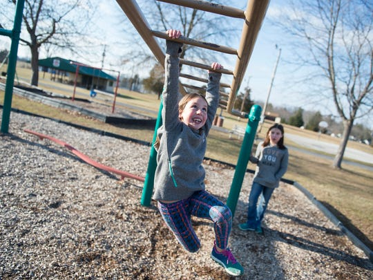 Madilyn Rosati, 6, and her sister Baylee, 8, both of Middletown, Va. play on equipment at the Gettysburg Recreational Park on Dec. 28, 2016. The park will receive new equipment after partial funding was approved at an Adams County Commissioners meeting in early December.