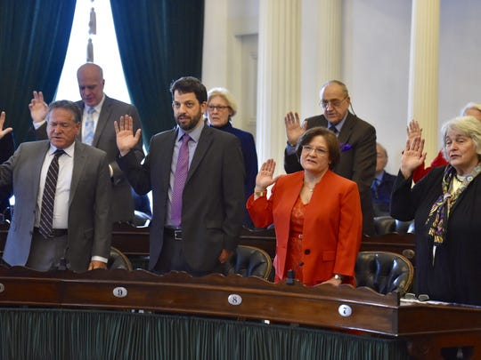 Senators take their oaths of office on the opening day of the Legislature at the Statehouse in Montpelier on Wednesday, January 4, 2017.