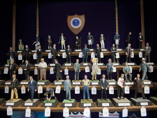 Clay figures of U.S. presidents are individually numbered