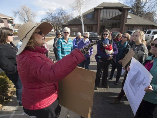 Janine Davis organizes a group of people outside U.S. Sen. Cory Gardner's Fort Collins office to meet with staff in regards to the possible repeal of the Affordable Care Act Tuesday, January 10, 2017. A few dozen protestors voiced their concerns with signs on S. Shields Street near the office.