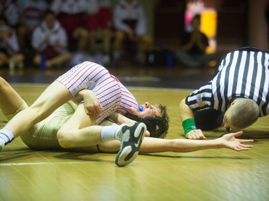 Bermudian Springs' Tyler Rawson pins Delone Catholic's A.J. Knobloch in the third period of the 120-pound bout on Thursday, January 19, 2017. Bermudian Springs secured a 44-24 win over Delone to clinch the Division III title.
