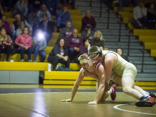 Bermudian Springs' Nate McCollum (bottom) wrestles Delone Catholic's Brady Repasky in the 182-pound bout on Thursday, January 19, 2017. Bermudian Springs pulled off a 44-24 win and clinched the Division III title.