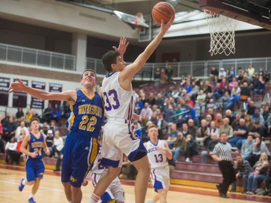 Spring Grove's Austin Panter puts the ball up against Waynesboro's Mitch Neterer during play on Saturday, Jan. 21, 2017. Spring Grove defeated Waynesboro 72-61.