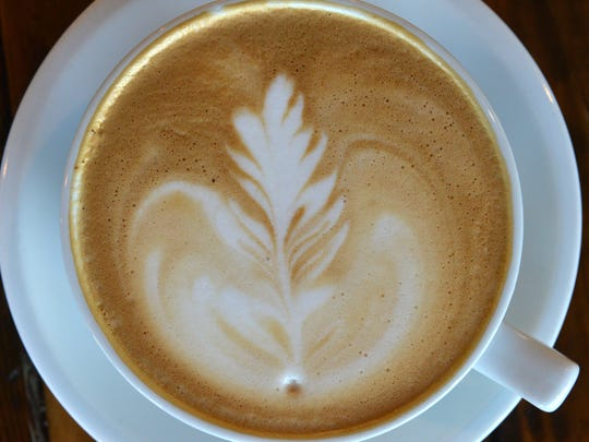 The decoratively poured café lattes are a signature item of Harvest Café in Ventura on Monday.
