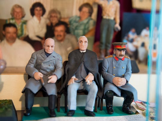 Clay figures of Winston Churchill, Franklin D. Roosevelt and Joseph Stalin depicting a scene from the Yalta Conference sit on a shelf in Chuck Caldwell's home. Caldwell, 93, served in the Pacific theater as a Marine during World War II.