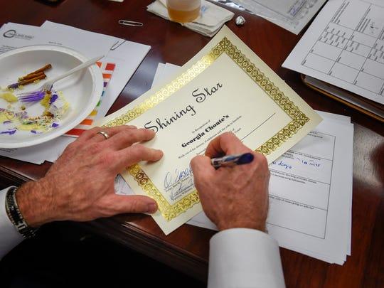 Circuit Duane Slone signs a graduating certificate