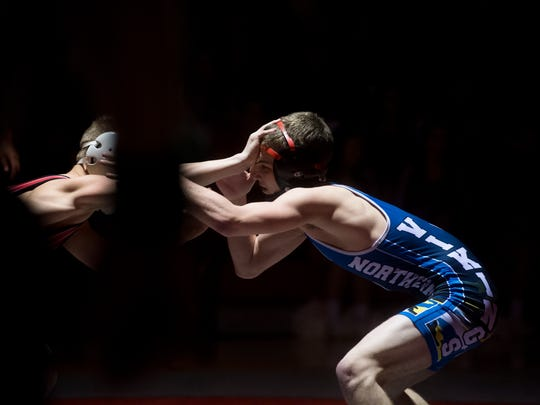 Northern Lebanon's Kyler Anspach (right) wrestles Bermudian