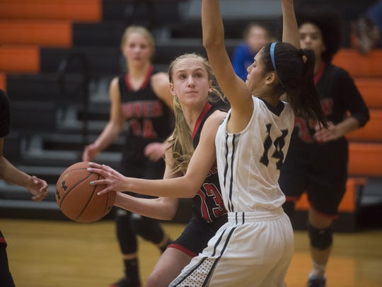 Dover's Ashley Goebeler looks to shoot the ball against