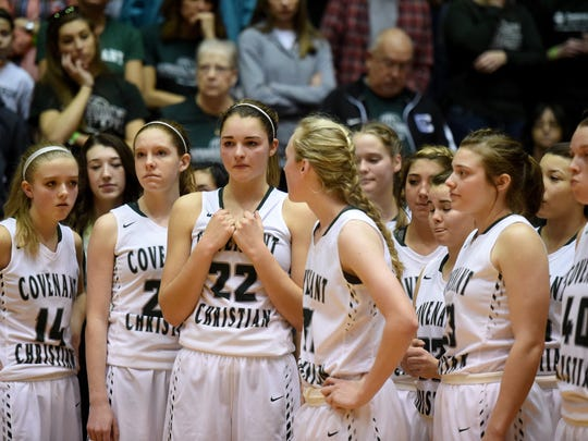 Covenant Christian players react after losing to Eastern High School as Richmond High School hosts the girls Class 2A semi-state basketball championship Saturday, Feb. 18, 2017, in the Tiernan Center.