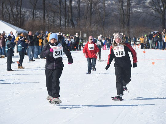 Amanda Vito, left, of the Genesee Region, and Kinsey Henry, right, of the Southern Tier Region, compete in a snowshoeing race during the 2017 Special Olympics New York Winter Games at Bowdoin Park in Wappingers Falls.