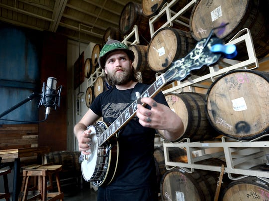 Ryan Stockham can often be seen playing the banjo at open mic night at Catawba Brewing Company.