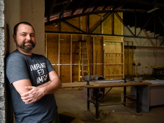 Aaron Clemins stand in the construction of his new restaurant Kuchnia & Keller in Germantown in Nashville, Tenn., Tuesday, Feb. 28, 2017.