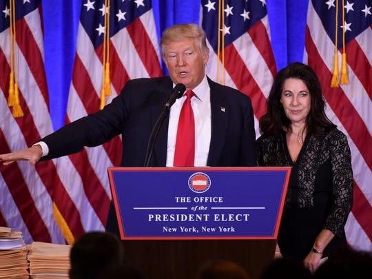 Donald Trump speaks at a press conference alongside
