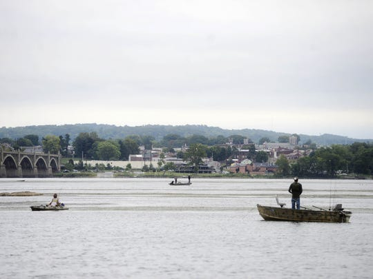 Boaters fish on the Susquehanna River just off the