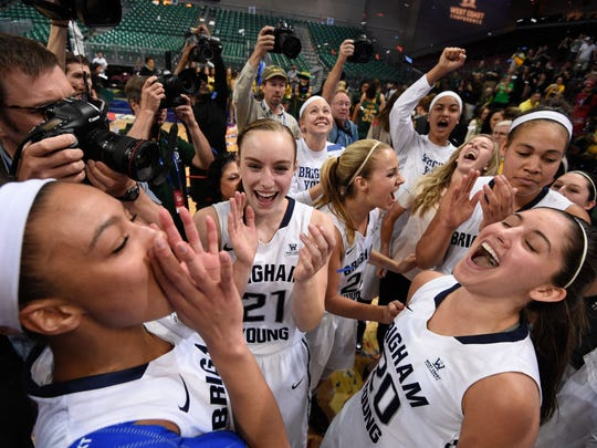 Brigham Young Cougars players celebrate against the