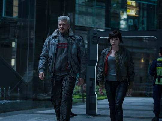 """The Major (Scarlett Johansson) and Batou (Pilou Asbaek) are partners in """"Ghost in the Shell."""""""