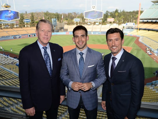 Joe Davis (center) will team with Orel Hershiser (left) and Nomar Garciaparra this season to call Dodger games.