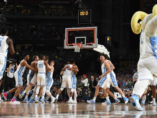 Apr 3, 2017; Phoenix, AZ, USA; North Carolina Tar Heels celebrate after defeating the Gonzaga Bulldogs 71-65 in the championship game of the 2017 NCAA Men's Final Four at University of Phoenix Stadium. Mandatory Credit: Bob Donnan-USA TODAY Sports