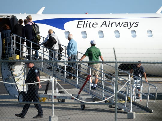 Passengers begin the boarding process on an Elite Airways