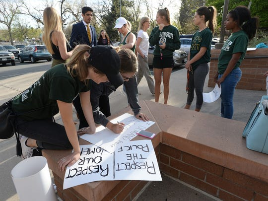 Students make signs at a rally Òfor police accountabilityÓ following the viral arrest video of CSU student Michaella Surat outside City Hall on Tuesday, April 18, 2017.