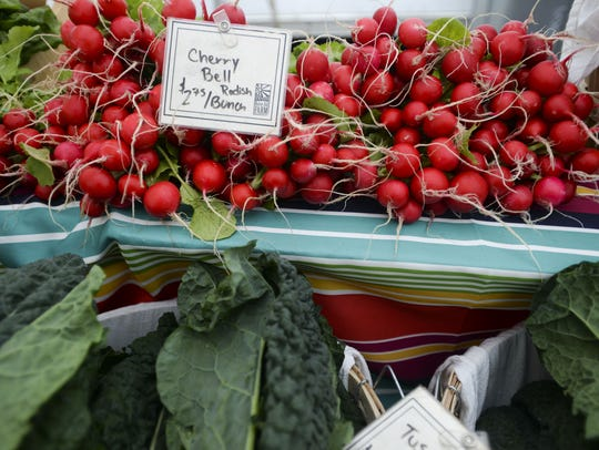 Native Hill Farm produce is on display during the Larimer