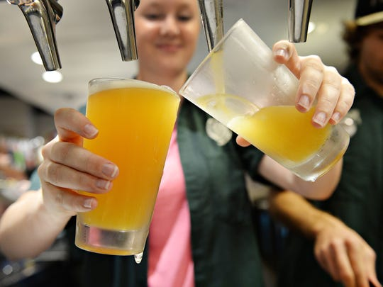 Audrey Meyer pours beers at CSU's Ramskeller at the