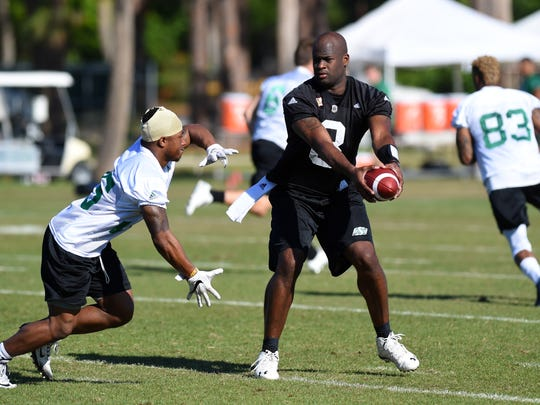 Former University of Texas and NFL quarterback Vince Young, takes snaps Tuesday, April 25, 2017, during the morning workout at Historic Dodgertown with the Saskatchewan Roughriders. Young was 30-2 at Texas and led the Longhorns to the national title with a Rose Bowl win over USC. He was drafted third overall in 2006 by the Tennessee Titans. Young played his last professional game in 2011. To see more photos, go to TCPalm.com.