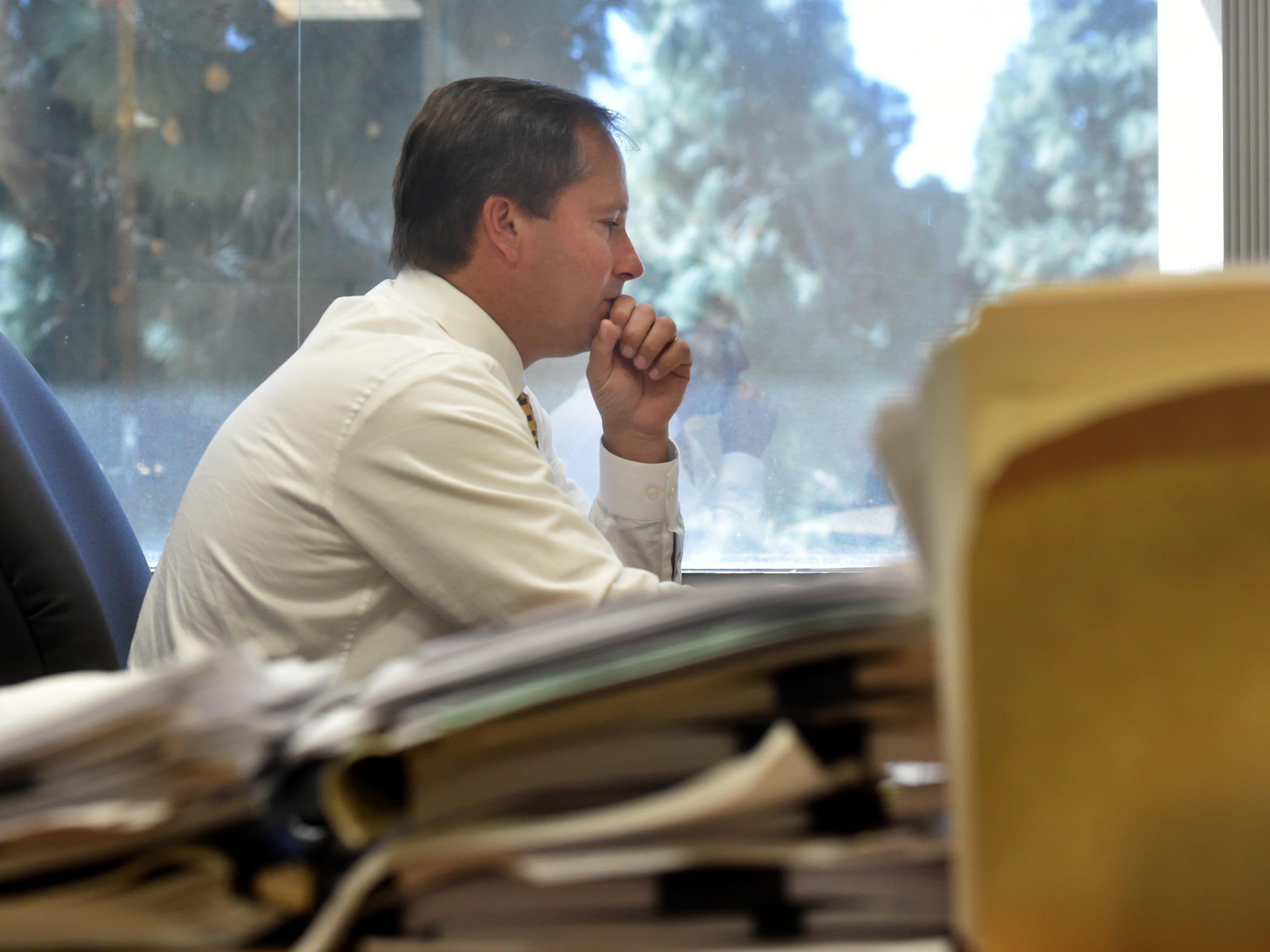 William Quest, a senior deputy public defender, works at his desk at the Ventura County Public Defender's Office.