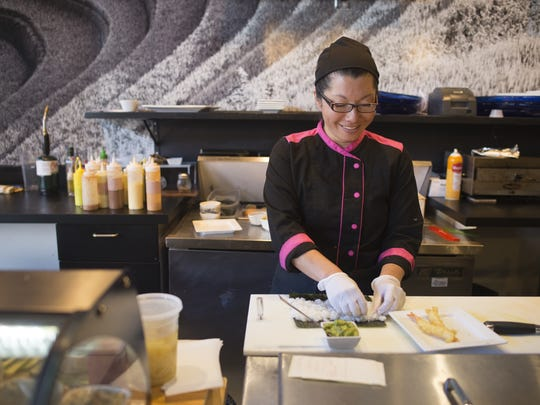Micki Hudson, head chef at Wabi Sabi on Linden Street prepares a sushi burrito in this file photo. The restaurant closed down in April.