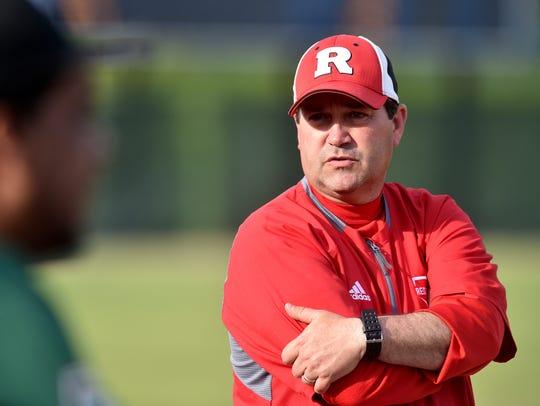 Richmond coach Shawn Turner talks to Arsenal Technical