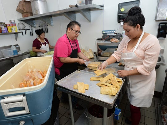 Arturo Montes and Veronica Himenez package tamales