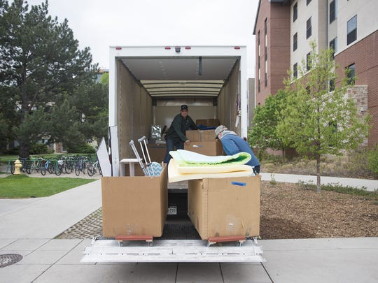 Daniel Hyatt and Aaron Leyte load a truck with donated items collected from CSU dorms on Thursday, May 11, 2017. The boxes will be transported for sorting to prepare for the Surplus Property tent sale starting June 3.