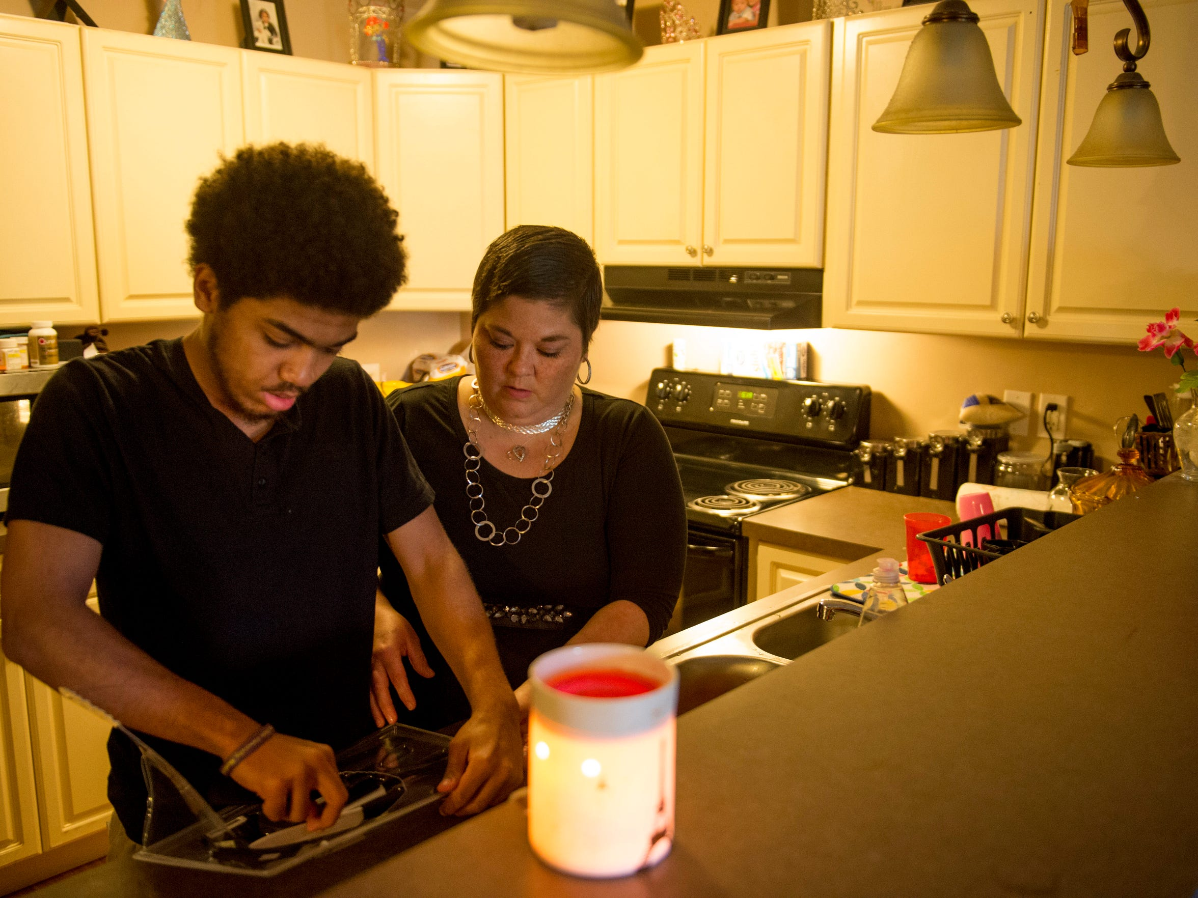 Heather Ota and her son, Brandon, 16, prepare for a night of steak fajitas in their Princeton, Ind., apartment Thursday evening. Since being diagnosed with her illness, Heather Ota's children have all become more responsible for themselves and each other.