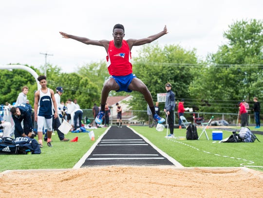 New Oxford's Abdul Janneh competes in the triple jump