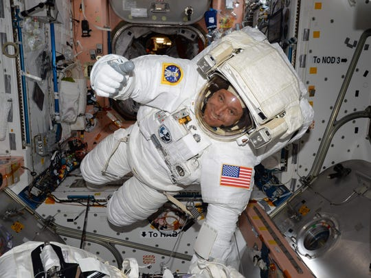 This NASA handout photo obtained shows Expedition 51 Flight Engineer Jack Fischer of NASA inside the International Space Station in his spacesuit during a fit check. Fischer and Peggy Whitson took part in a spacewalk on Friday.