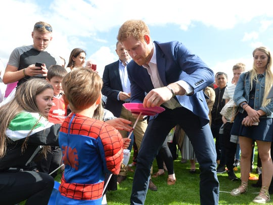 Prince Harry plays with a young boy during the Party