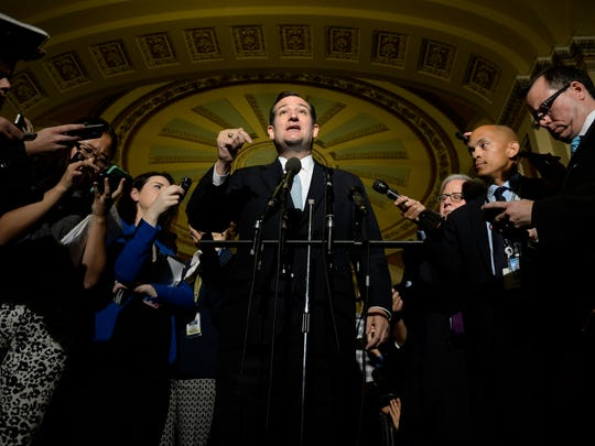 Sen. Ted Cruz talks to members of the media after Republican