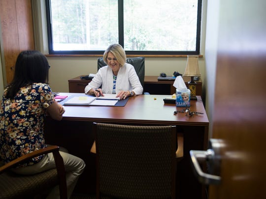 At right, Sherry Price, a lead case manager, and Emilee Scott, a case manager at the nonprofit Mountain Tough, speak May 18, 2017, in their new office in Gatlinburg.