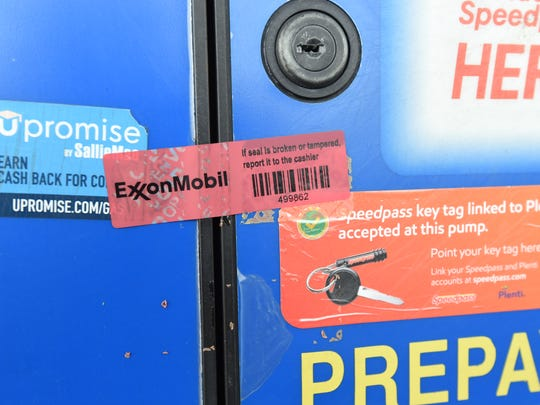 A red piece of tape placed over an access panel on a Mountain Home gas pump shows the access panel has not been compromised. Thieves break into these panels to install one type of device that steals debit card information.