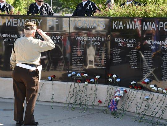 Livonia VFW Post member, Richard Schmidt salutes after