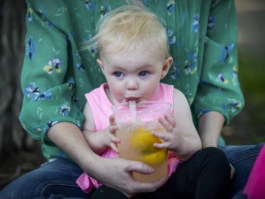 Andrea Stephenson holds her daughter Ashley as she