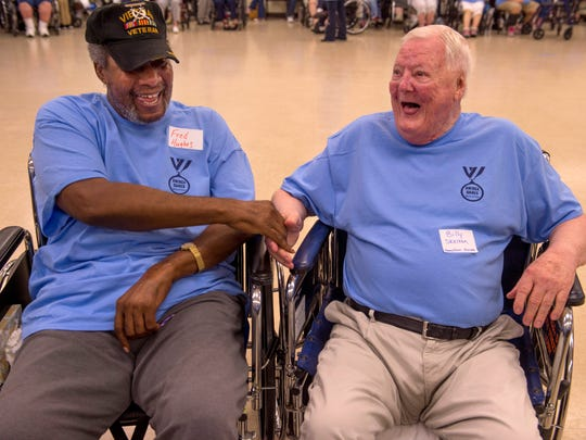 Fred Hughes, left, and Billy Skelton congratulate each other on a good wheelchair race during the Warrick County Southwest Indiana Regional Council on Aging (SWIRCA) Assisted Living and Nursing Home Games at the Chandler Community Center Wednesday morning.