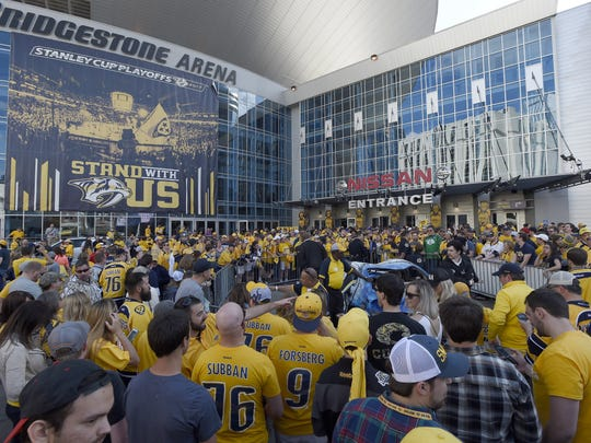 Predators fans celebrate after the series-clinching win in game 6 of the second round NHL Stanley Cup Playoffs at the Bridgestone Arena  Sunday, May 7, 2017, in Nashville, Tenn.