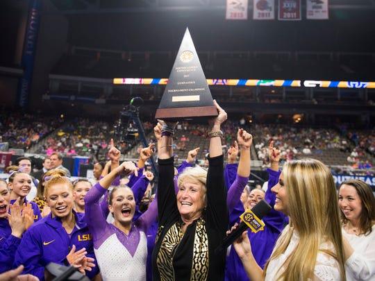 LSU's women's gymnastics team, led by coach D-D Breaux, celebrates the team's 2017 SEC Tournament championship.