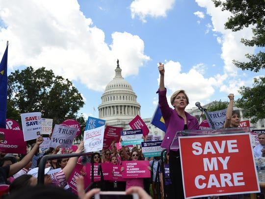 Sen. Elizabeth Warren, D-Mass., speaks at a rally to