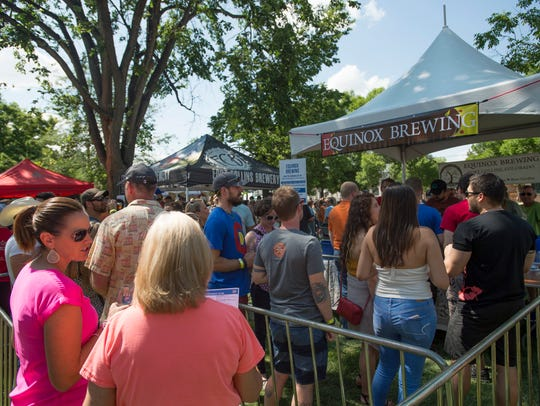 Beer fans wait to sample brews from Equinox Brewing